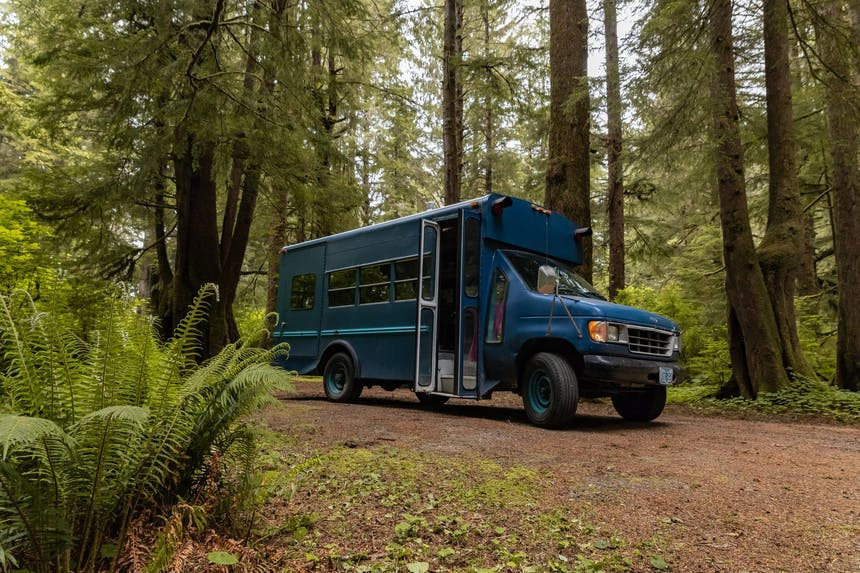 Claire's blue bus in old growth forest