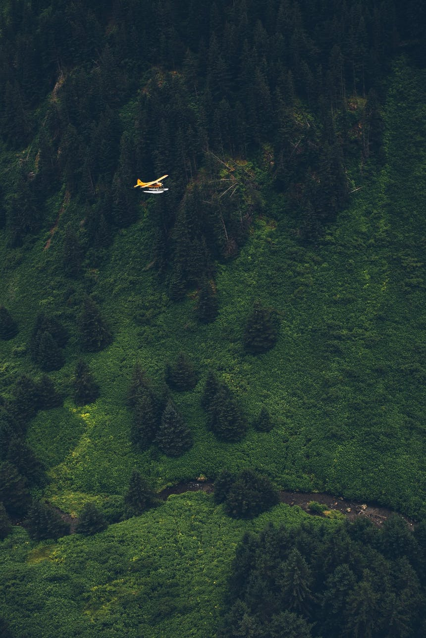 flying through a valley on a sea plane