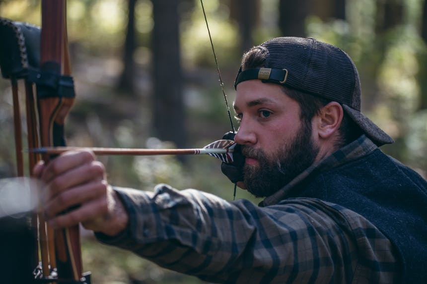 hunter shooting his bow