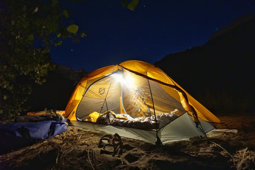 tent camping with light under starry sky
