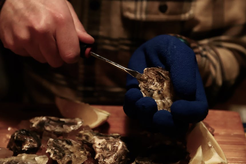 shucking oyster with a screwdriver