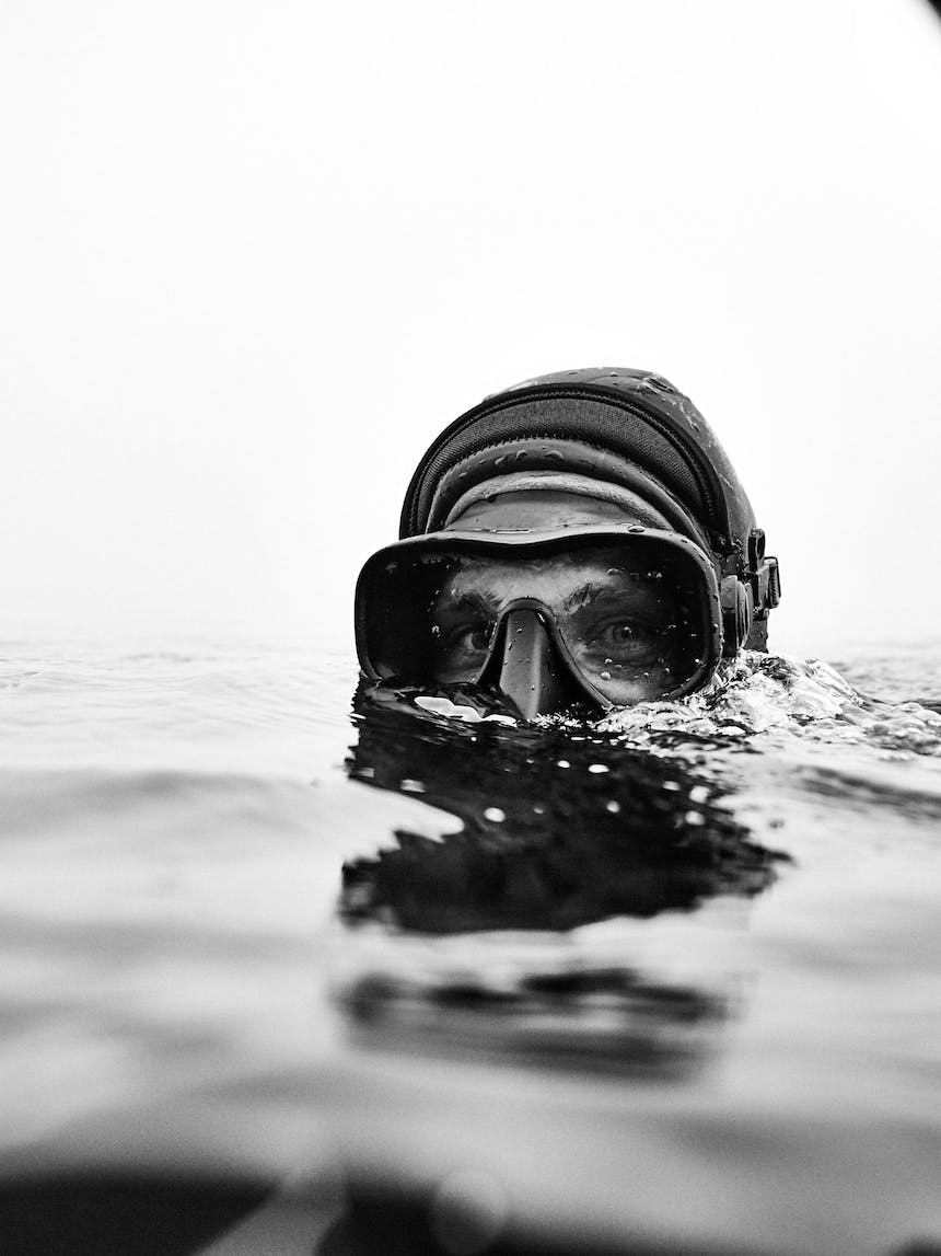 pat in the water with goggles and snorkel