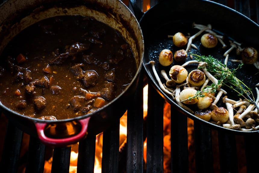 mushrooms and venison stew on wood fired grill