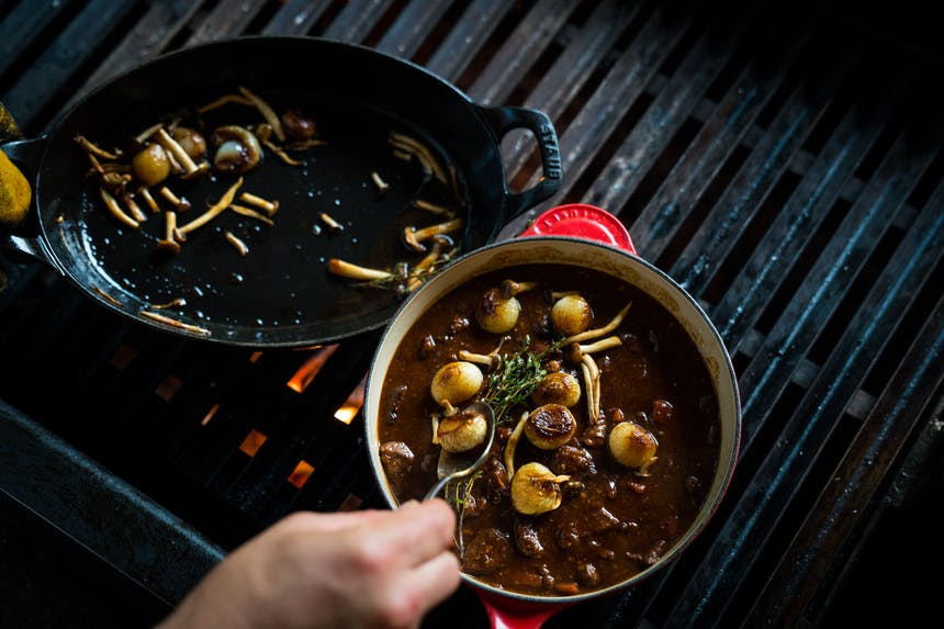 putting mushrooms in the venison stew