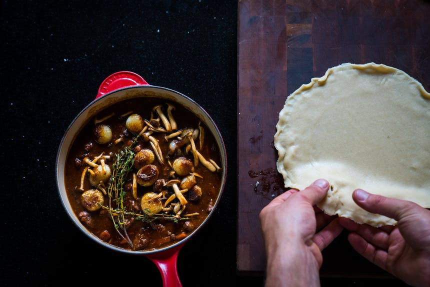 savory pie prep with mushrooms and venison in cast iron skillet