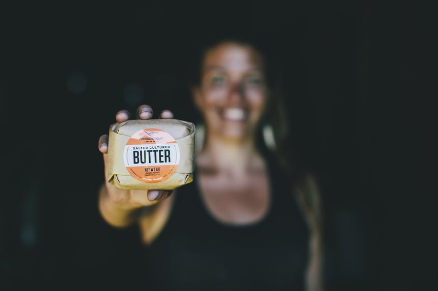 Marisa holding a package of her butter