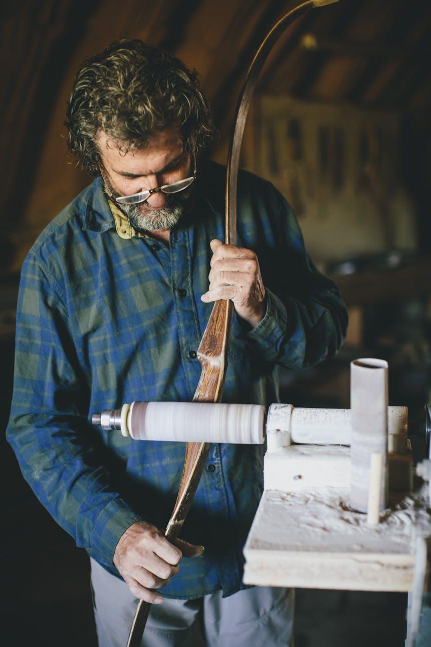 Dick sanding a bow on circular sanding lathe
