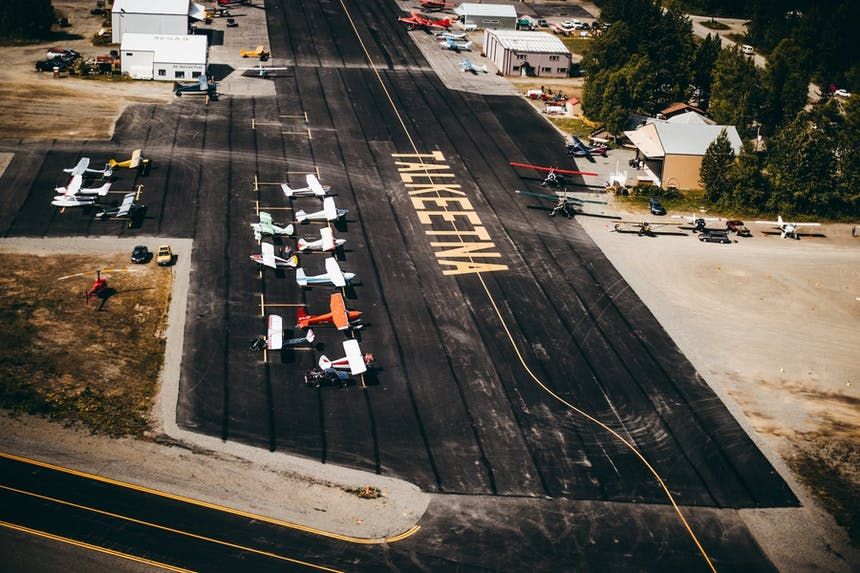 talkeetna airport tarmac with multiple small craft parked