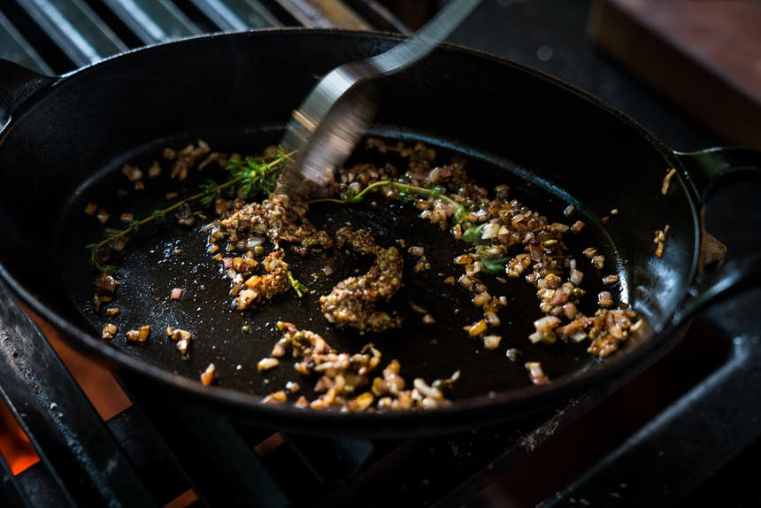 toasting garlic and herbs in cast iron skillet