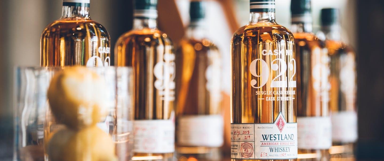 bottles of whiskey sitting on bar